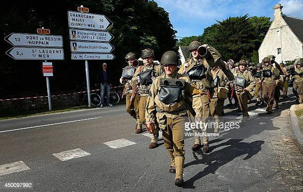 Military enthusiasts march outside their camp just south of Omaha Beach on the day before the 70th anniversary of DDay June 5 2014 in Vierville...