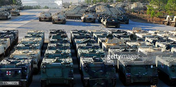 Military equipment sits in a storage yard on Tuesday December 5 at the Anniston Army Depot in Anniston Alabama where military heavy equipment is...