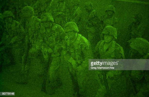 US military executing night manuevers during training camp