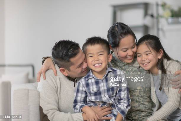 military family sitting on couch - daily life in philippines stock pictures, royalty-free photos & images
