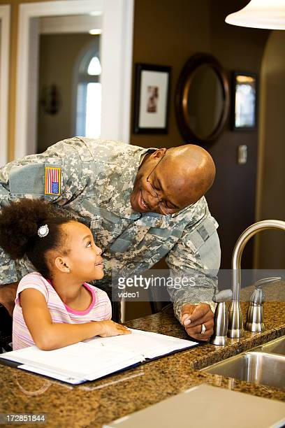 military father helping daughter with homework  - nigerian airforce stock photos and pictures