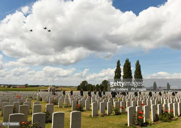 A military flypast over Tyne Cot Commonwealth War Graves Cemetery in Ypres Belgium during a commemoration ceremony to mark the centenary of...