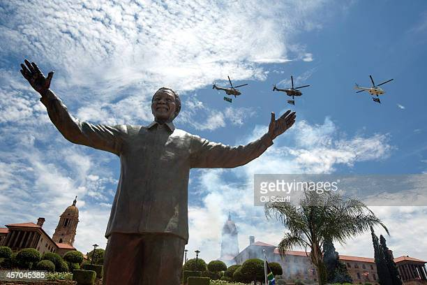 A military flypast takes place above a statue of former South African president Nelson Mandela shortly after its unveiling at the Union Buildings on...