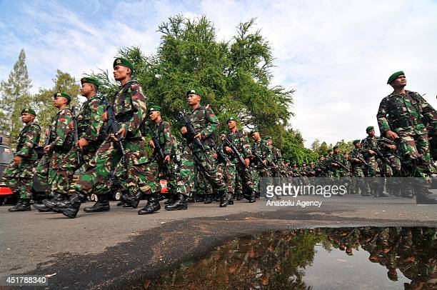 Military forces march during the security preparations for forthcoming presidential election in Surakarta Indonesia on July 7 2014 The Jakarta...