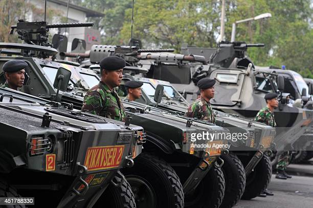 Military forces stand between armored military vehicles during the security preparations for forthcoming presidential election in Surakarta Indonesia...
