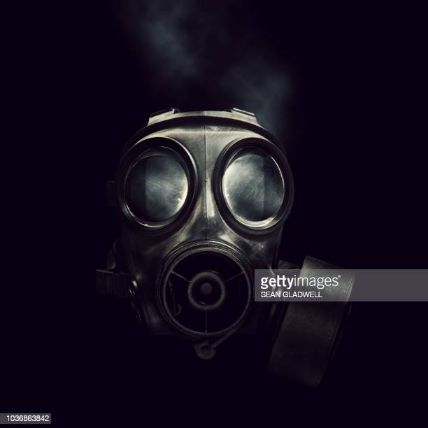 military gas mask - gas mask stock pictures, royalty-free photos & images