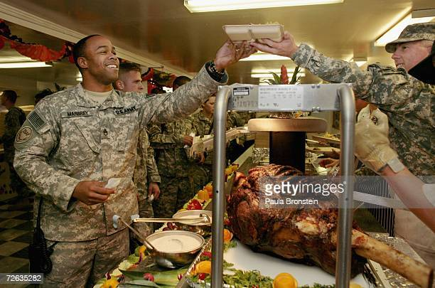 S military get served a special Thanksgiving meal at the Bagram military base in Bagram Afghanistan November 23 2006 The meal was served to at least...