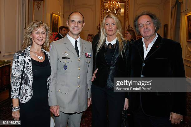 Military Governor of Paris General Bruno Le Ray his wife Agnes Alice Bertheaume and Gonzague Saint Bris attend the Reception for the King of Belgians...