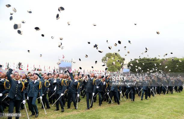 Military graduates toss their hats in the air at the 74th anniversary of the founding of Lebanese Armed Forces is held at the military academy in...