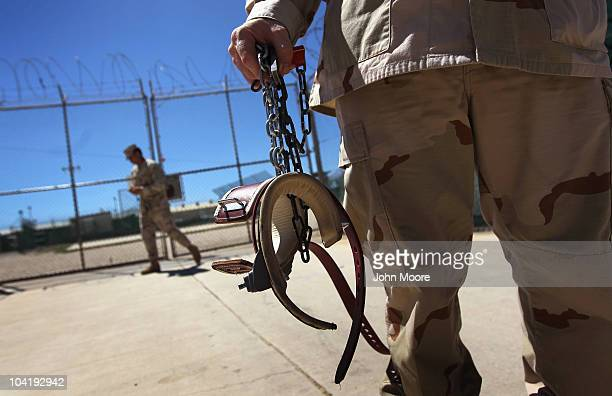 A US military guard carries shackles before moving a detainee inside the US detention center for enemy combatants on September 16 2010 in Guantanamo...