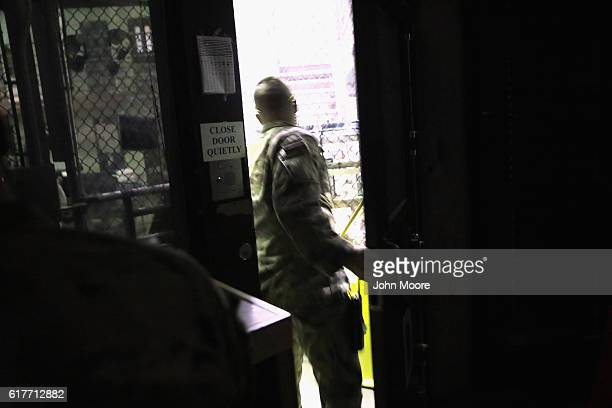 A US military guard listens to a prisoner's request at the Gitmo maximum security detention center on October 22 2016 at the US Naval Station at...
