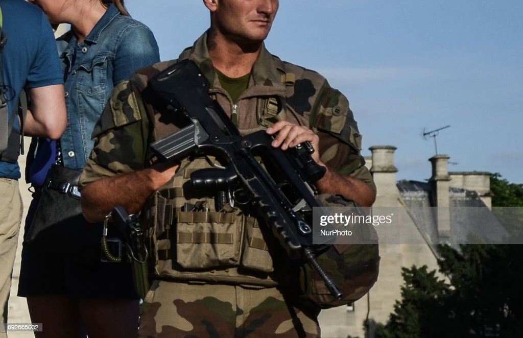 Military guard the place around Notre Dame de Paris cathedrale. People used the first days of the summer for walking around the French capital of Paris. The temperature of the weather is about 25 celsius degrees Paris, France on June 04, 2017