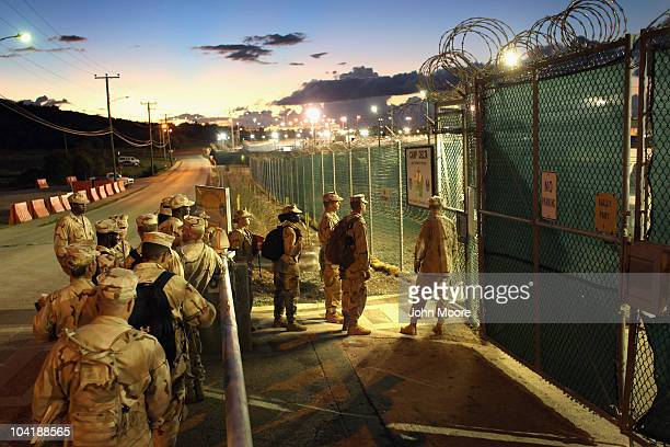 US military guards arrive for their sunrise shift at Camp Delta at the US detention center for enemy combatants on September 16 2010 in Guantanamo...