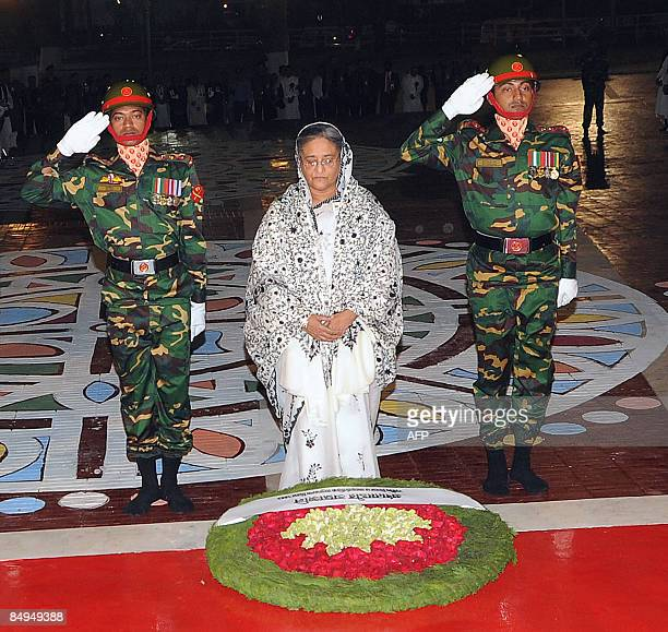 Military guards assist Prime Minister Sheikh Hasina Wajed in laying a wreath at the altar of Dhaka's monument for Bangladesh's Language Movement...