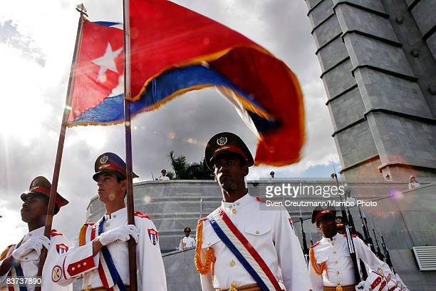 Military guards carry the Cuban and Chinese flags during a wreath laying ceremony at the Jose Marti monument on the Plaza de la Revolucion November...