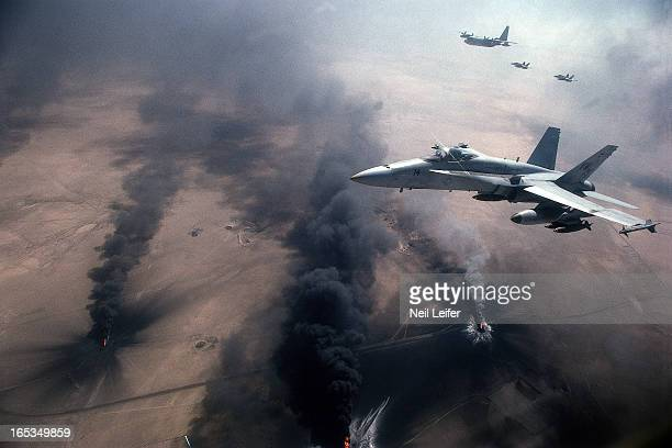 Gulf War Aerial view of US Marine F18 Hornet fighters while flying over burning oil fields Kuwait 3/5/1991 CREDIT Neil Leifer