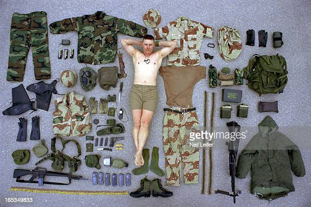Gulf War Portrait of US Army Sergeant Duane Clemons surrounded by all of his battle gear during photo shoot Dhahran Saudi Arabia 2/24/1991 CREDIT...