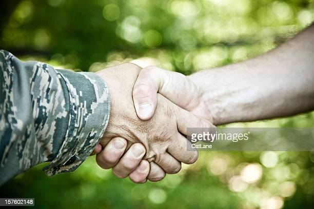 military handshake - civilian stock pictures, royalty-free photos & images