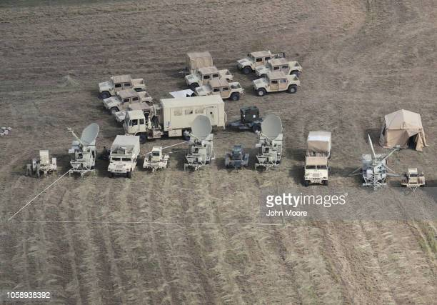 Military hardware sits parked at a US Army camp under construction at the USMexico border on November 7 2018 in Donna Texas The forward operating...
