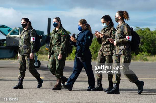 Military health professionals walk to the Armed Forces helicopter for the flight to the Auaris region where they will serve indigenous people from...