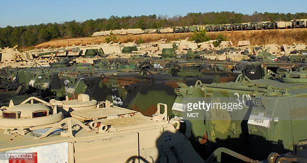 US military heavy equipment sits in a storage yard on Tuesday December 5 at the Anniston Army Depot in Anniston Alabama where they are overhauled...