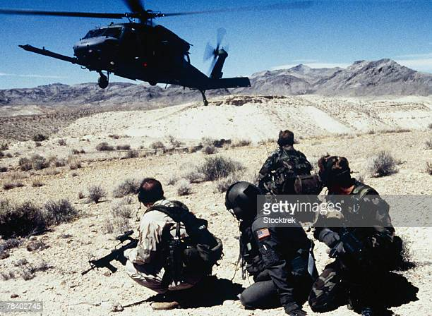 Military helicopter and rescue team
