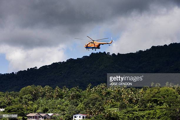 A military helicopter arrives in Fomboni the capital of Moheli on March 22 2008 A fresh batch of African Union troops arrived on the Comoros island...