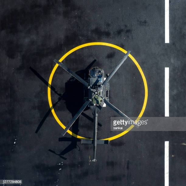 military helicopter at helipad - airfield stock pictures, royalty-free photos & images