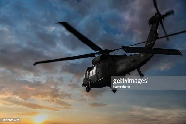 military helicopter flaying at sunset - us military stock pictures, royalty-free photos & images