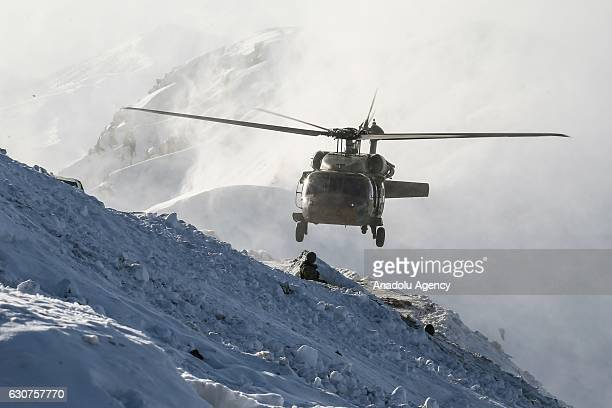 A military helicopter flies during an operation against PKK terrorists in Hakkari Turkey on December 30 2016 Turkish Armed Forces frequently conduct...