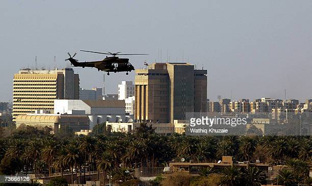 S military helicopter flies over the green zone after a press conference by Iraqi Prime Minister Nuri alMaliki and UN SecretaryGeneral Ban Kimoon on...
