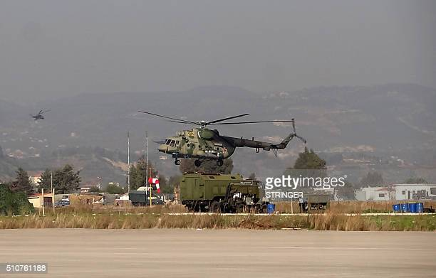 A military helicopter is seen at the Russian Hmeimim military base in Latakia province in the northwest of Syria on February 16 2016 / AFP / STRINGER