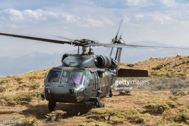 military helicopter landed - helicopter stock pictures, royalty-free photos & images