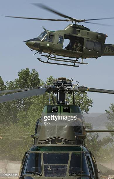 A military helicopter lands in Khwazakhela base helicopter lands at Pakistani soldiers take cover as an helicopter takes off from the top of a...