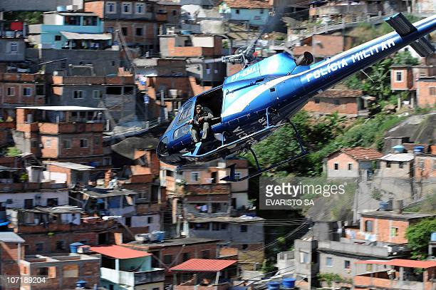 A military helicopter overflies the Morro do Alemao shantytown during the raid on November 28 2010 in Rio de Janeiro Brazil After days of preparation...