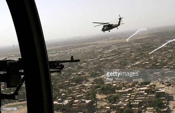 S military helicopter shoots flares flying over the city skies October 5 2006 in Baqouba Diyala province Iraq The US Ambassador to Iraq Zalmay...