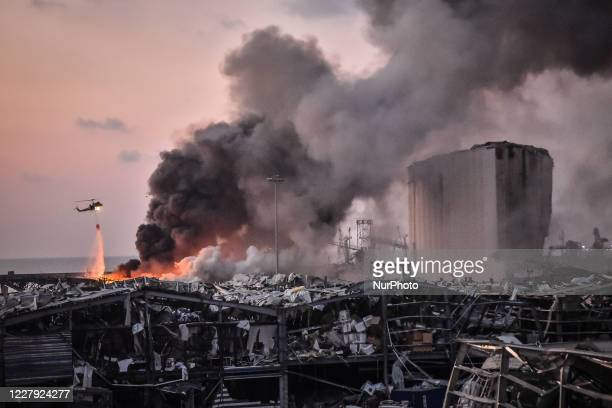Military helicopter tries to put out a fire at the port after the explosion on August 4, 2020 in Beirut, Lebanon. According to the Lebanese Red...