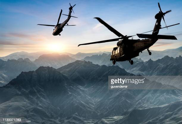 military helicopters flying against sunset - military stock pictures, royalty-free photos & images
