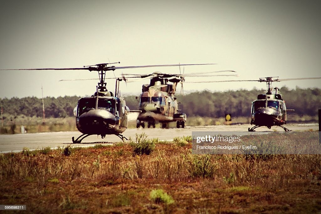 Military Helicopters On Army Base Against Sky : Bildbanksbilder