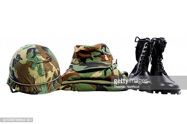 Military helmet, hat, shirt and boots