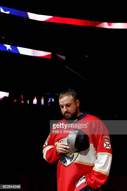 Military Hero and US Army Veteran William Marshall stands on the ice for the national anthem During Military appreciation night prior to the Florida...