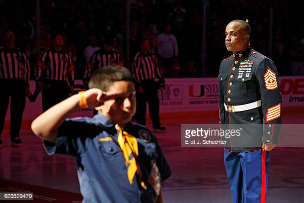 Military Hero and US Marine and cancer survivor Steven Ellison stands at attention on the ice for the national anthem Prior to the start of the game...