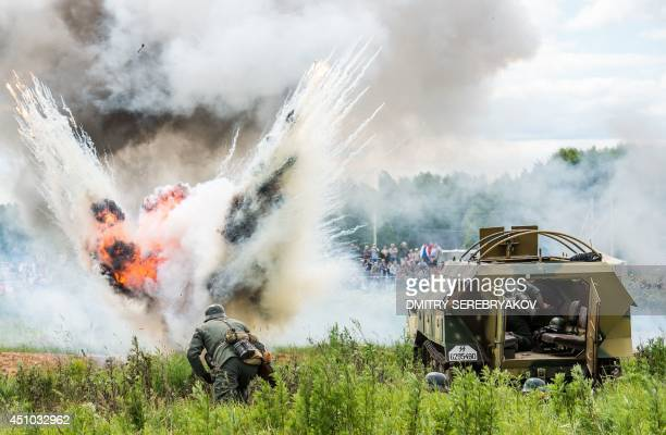 Military history enthusiasts dressed as a Nazi Germany's troops take part in a stage battle 'Summer 1941' near the village of Ivanovskoye some 60 km...