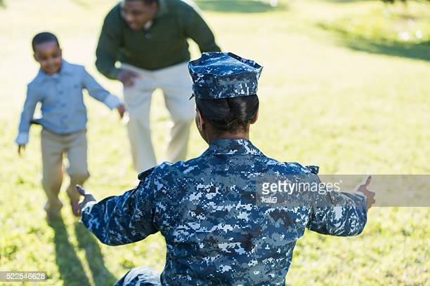 Military homecoming, navy mother reaching for son