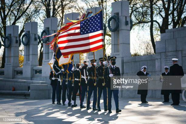 Military honor guard arrives at the World War II Memorial for a wreath-laying ceremony to mark National Pearl Harbor Remembrance Day on December 7,...