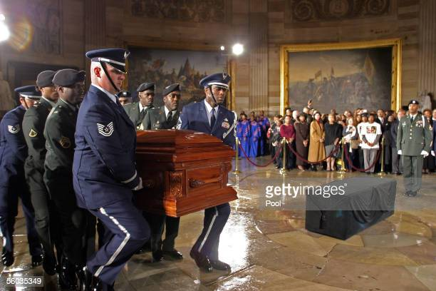 A military honor guard carries the casket of civil rights activist Rosa Parks into the US Capitol Rotunda October 30 2005 in Washington DC Parks is...