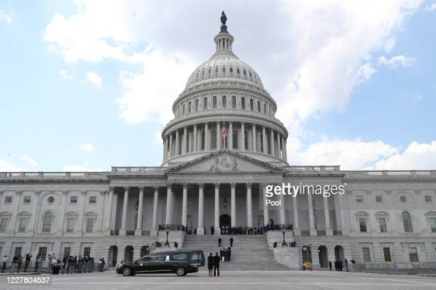 Military honor guard carries the casket of former Rep. John Lewis up the U.S. Capitol steps prior to a memorial service in the Capitol Rotunda on...