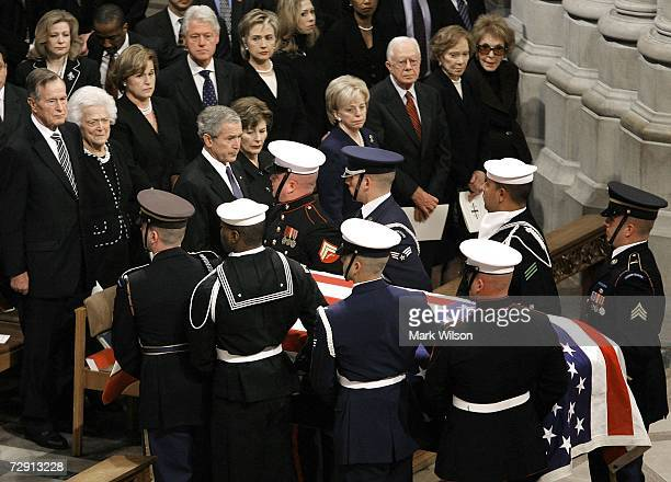A military honor guard carries the casket of former US President Gerald Ford past US President George W Bush first lady Laura Bush Lynn Cheney former...