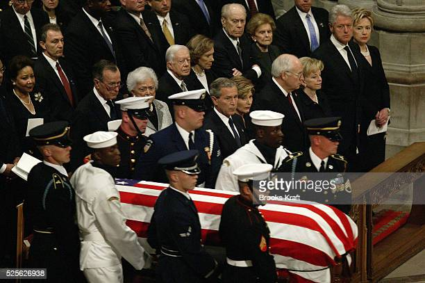 A military honor guard carries the casket of former US President Ronald Reagan during his funeral at the National Cathedral in Washington To the...