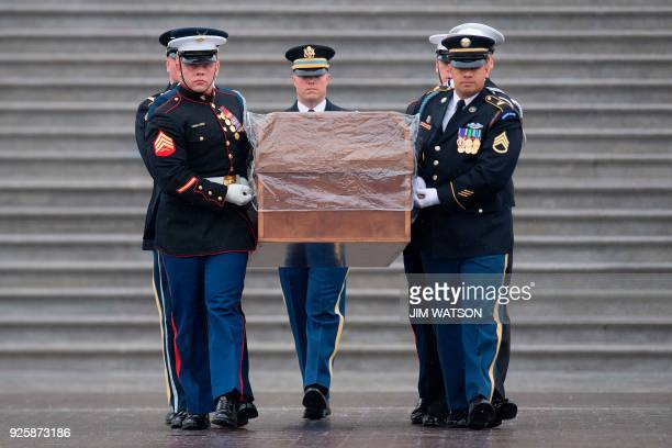 Military Honor Guard carries the casket of Reverend Billy Graham as it departs the US Capitol in Washington DC March 1 after a Lying in Honor...